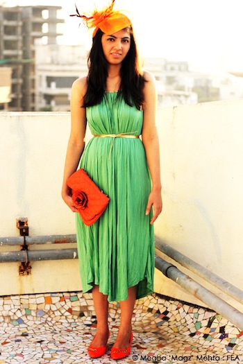 Green dress with rope straps and belt (to be tied), an orange flower clutch, orange kitten heels and an Orange Fedora to complete the look