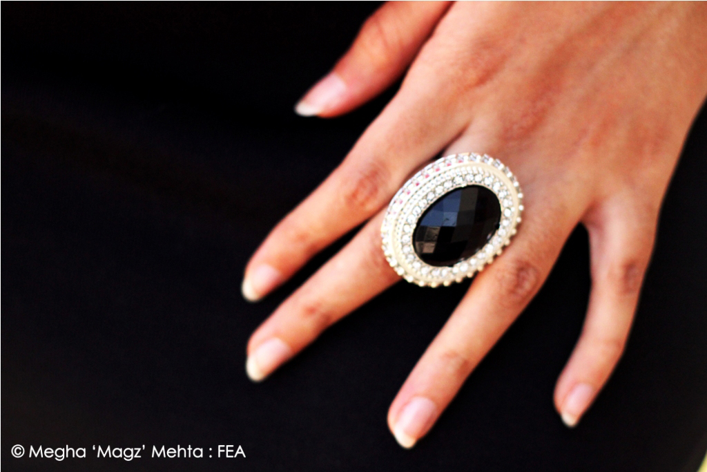 Black ring outlined with white diamantes